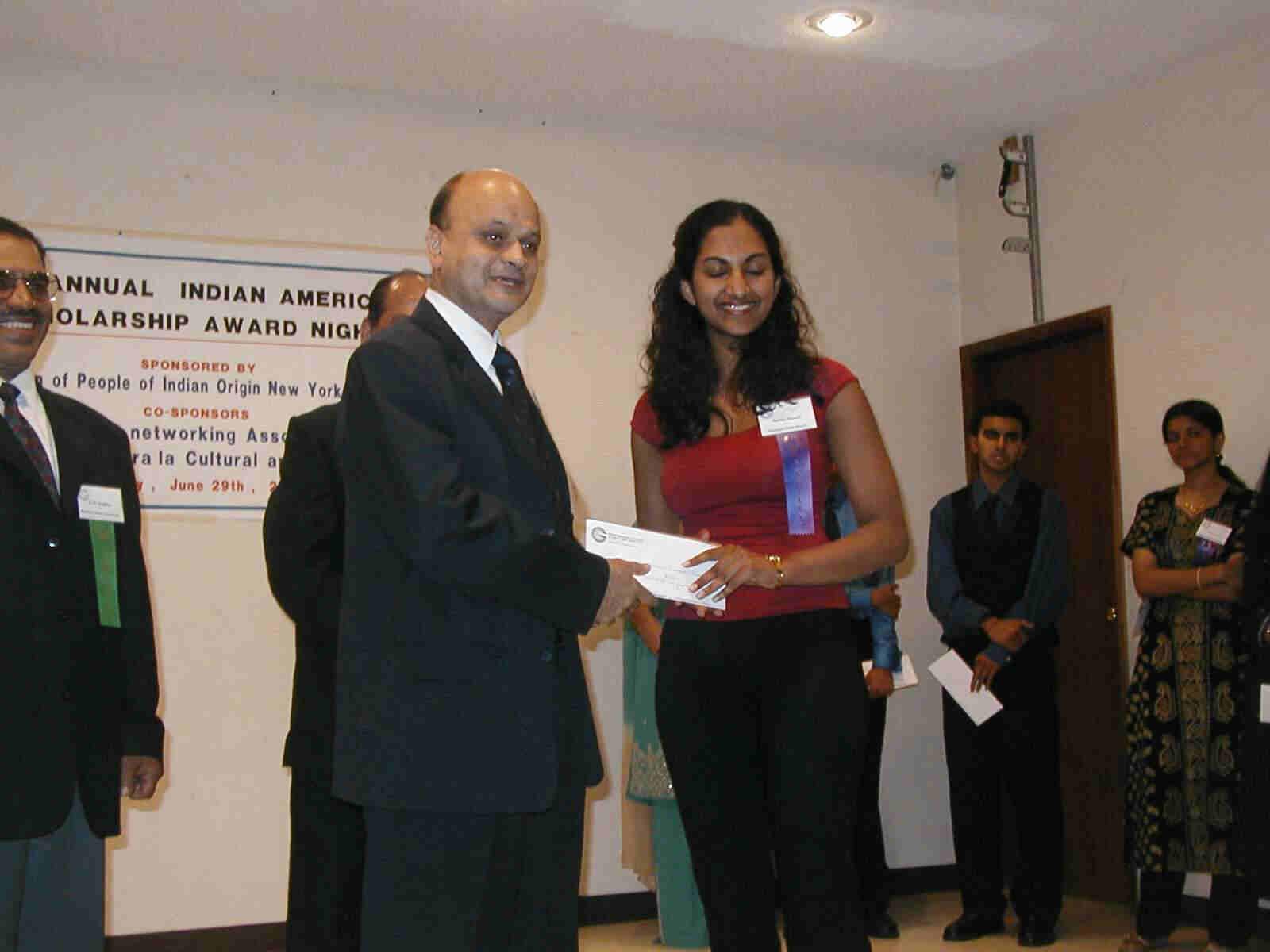 consul general pramathesh rath presenting the outstanding academic achievement scholarship award 2000 to sarika bansal of ramapo high school